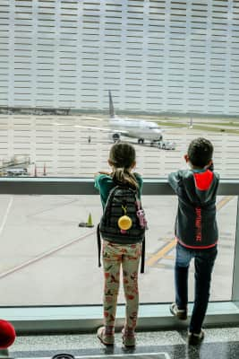 Kids waiting at the airport