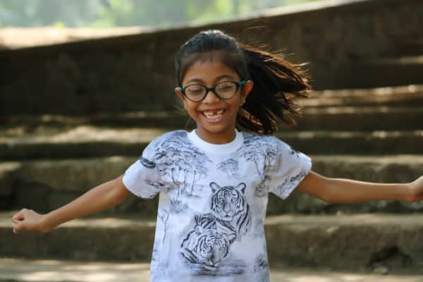 Girl child very happy having fun outdoors
