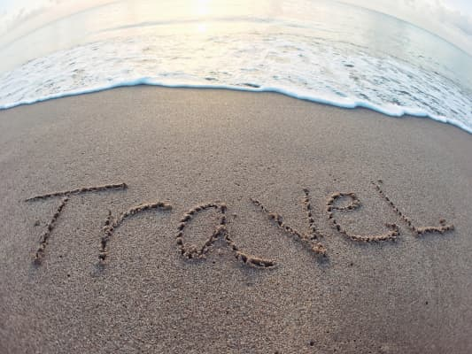 Travel written on the sand