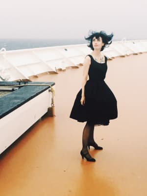 Vintage formal wear on the deck of a cruise ship