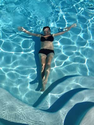 Woman under water revealing ambient reflective pose