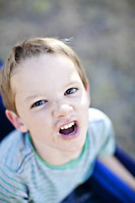Boy with a dusty face makes a face