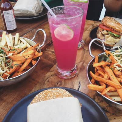Roam Burger in Lafayette, California. Regular, sweet potato, and zucchini fries cooked in rice oil; veggie quinoa burgers, and their artisan sodas: real fruit purée mixed with carbonated water and sweetened with agave syrup.