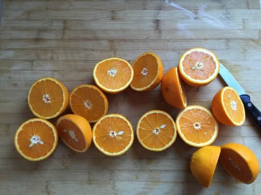Fresh oranges cut and ready to make juice