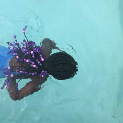Swimming in the pool.