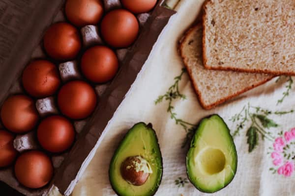 Ingredients for avocado toast with fried egg.