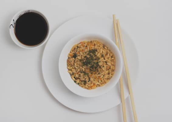 The bowl of rice on a white background.
