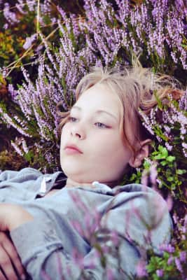 Girl lays in the heather