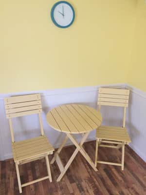 Table, chairs and a clock