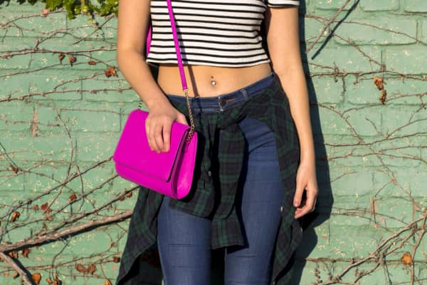 Girl in flannel, pink purse