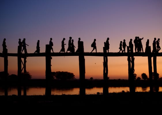 People silhouette on teak bridge