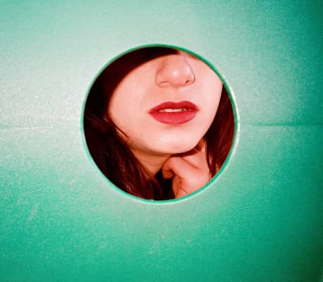 Lips through a tunnel at a playground/park. Taken with a Yashica T4.