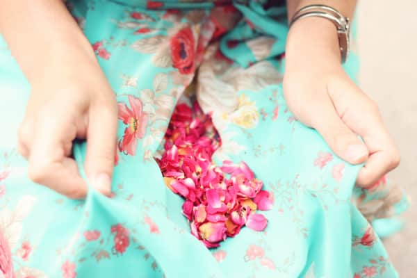 Red rose petals on a floral pattern dress