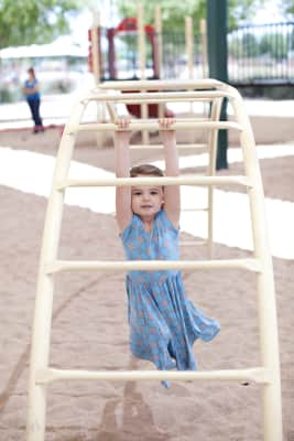 girl playing on a playground in the park