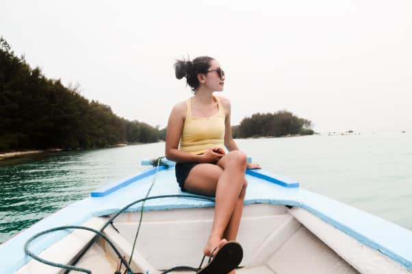 Girl on the boat, with beautiful nature on the background.