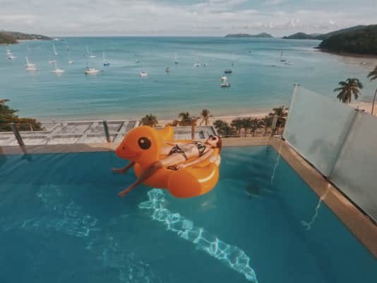 Woman lying on a giant duck inflatable!