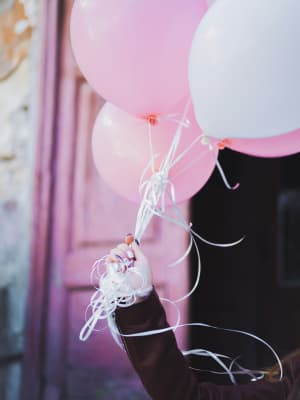 Birthday girl with pink balloons