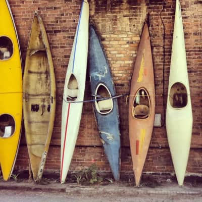 walked past the building and discovered a bunch of old kayaks against the wall. Made for a good photo shoot