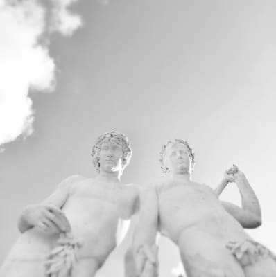 Brotherhood or Love. White marble nude men statues, sunlight and clear sky, monochrome, light gray, inspirational moments, black and white photography, gay love, lgbt
