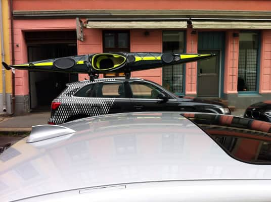 Don't ask yourself to make a choice between your canoe and your car when you drive in the city, street, facade, parked cars, natural daylight, copy space