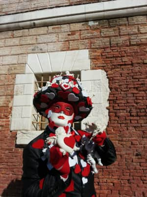 Venice Carnival ... Best carnival in the world, when poetry and mystery meets city life... Venice, Italy, person wearing a mask outdoors, artisanal work, brick wall, sunny day, urban, red heart, love, costume