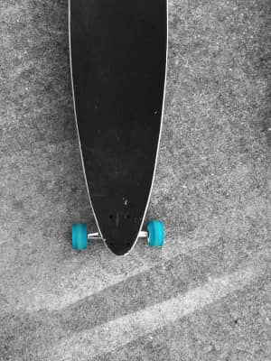 Minimal perspective skate board with blue wheels