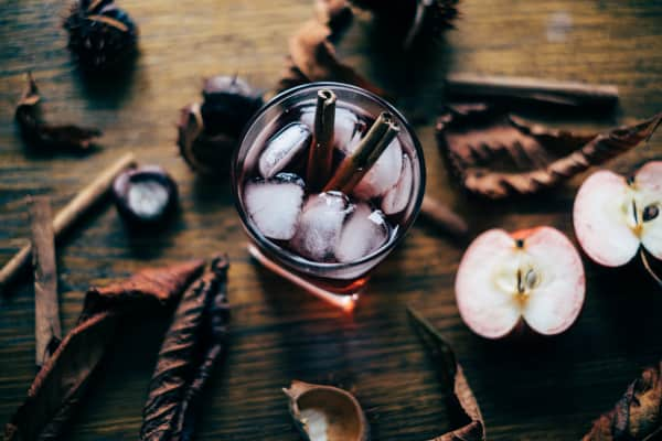 Apple cider with cinnamon sticks