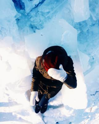 Woman relaxing in frozen ice