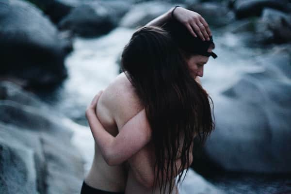 Two lovers embracing within mother nature