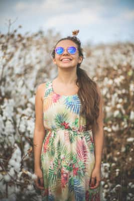 A happy girl In a cotton field