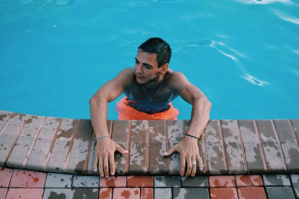 Man on swimming pool