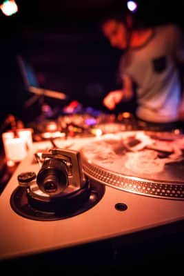 DJ, party, music, mixer, tunes, night-club, nightlife, music instrument, art, music artist, art, partying, table, mixing table, blurry background, shallow depth of field, dof, neon lights, neon,