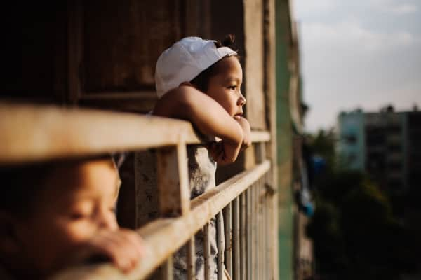 Kids having a quiet time in the balcony, kids, thinking, big brother, balcony, moments, family, two, people, sunset, natural light, backward, hat, white hat,