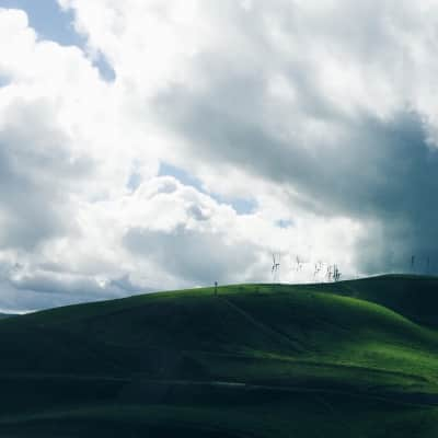 Green mountains with clouds.