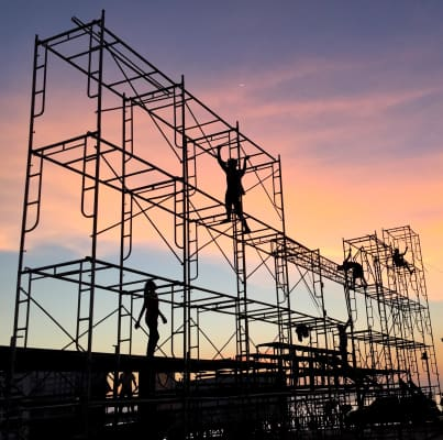 Workers are doing their job with sunset background.