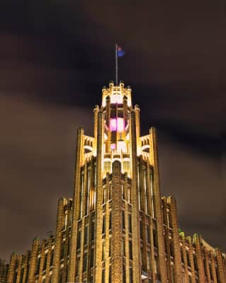 This is the The Manchester Unity Building a neo gothic skyscraper in Melbourne, Australia, constructed in 1932. Its a rare blend of art, science, culture and commerce. This is a heritage listed building located in Swanston Street, Melbourne.  Looks like a scene from a movie at night.