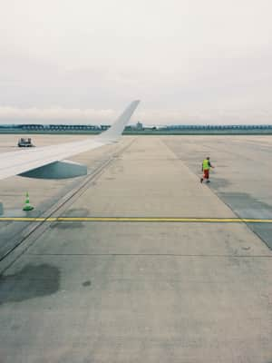 Airplane on the tarmac, Ready for take off, airport, horizon, travel, traveling, vanishing point, monochrome, incidental people, copy space