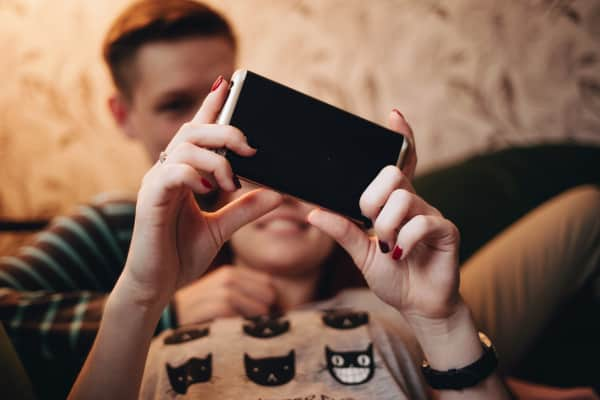 Teenagers using mobile device