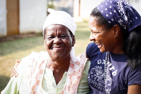 A South African Gogo laughs with a friend.