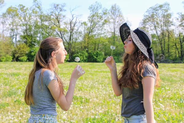 Blowing Dandelions at Each Other;    Where I stand;   Light & Tranquil Nature;   Girlfriends having a stress-free Healthy Living Relief Day at the Park;   Earth Day tones;   People holding Spring flowers;  Gen Z Zoomers