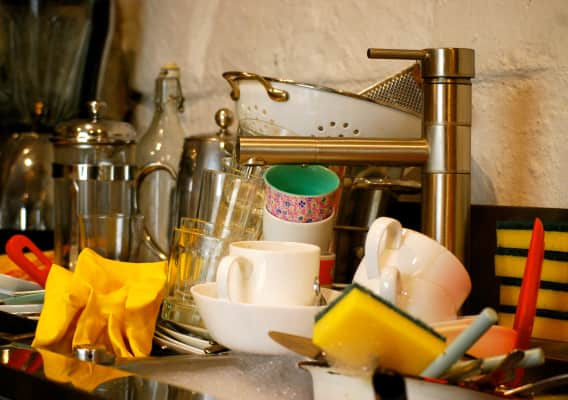 Washing up piled up in kitchen