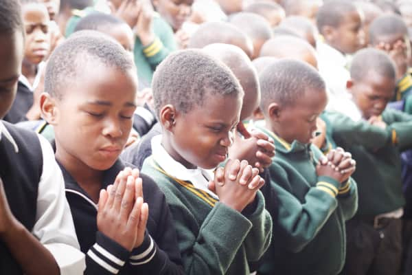 They start off their school days with prayer in Embo, South Africa.