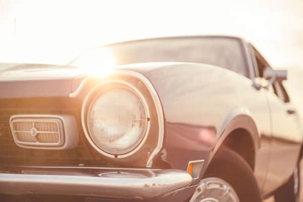 Muscle car in sunset.