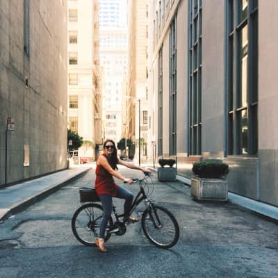 Young woman on bicycle in the city.
