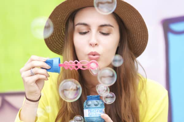 Bubble blowing girl