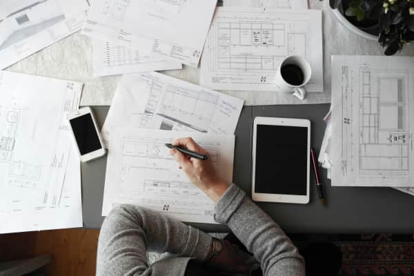 Architect. Design. Planning and organizing.DIY Desk work paperwork from above business strategy planning budgeting finance economy using technology