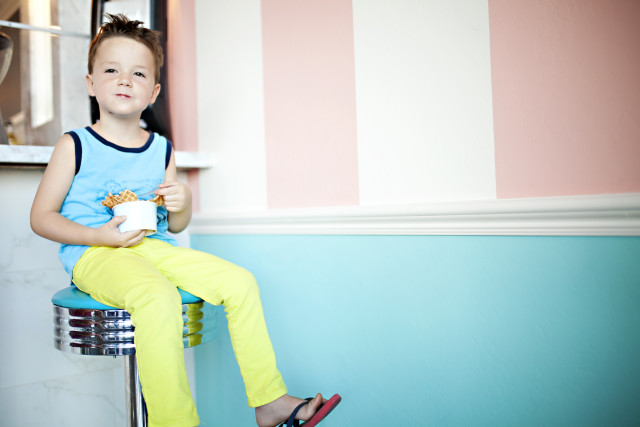 boy in bright clothes eating ice cream