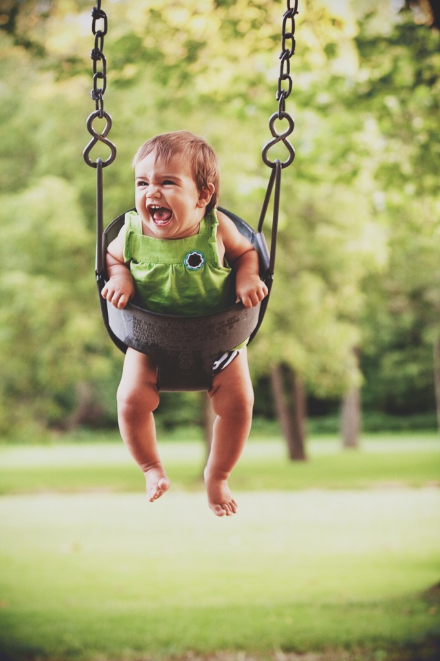 Baby swinging in a swing so happy