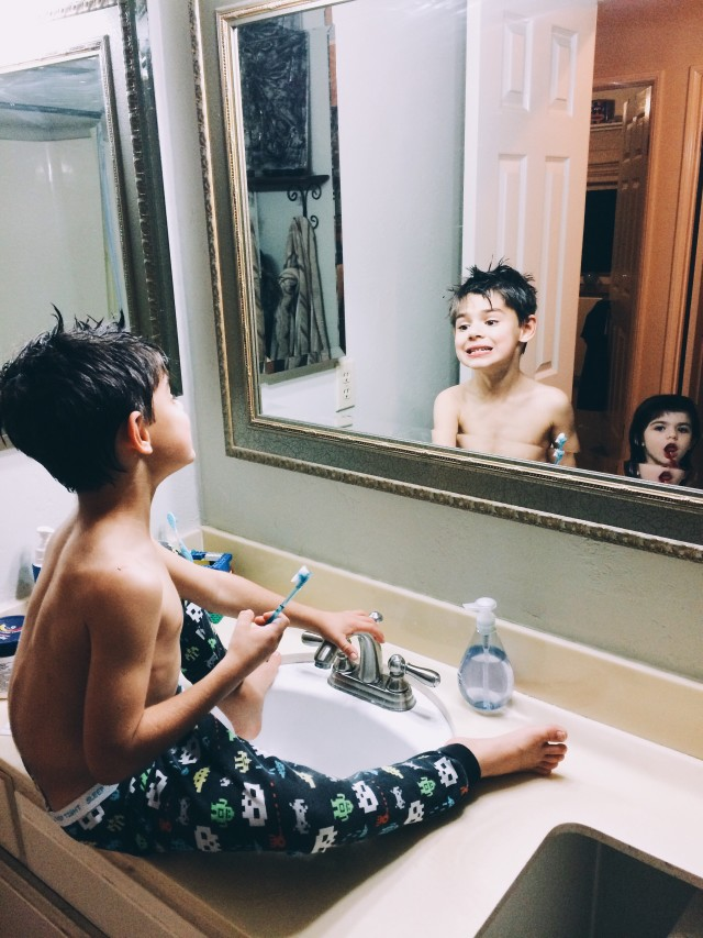 Kids brushing their teeth