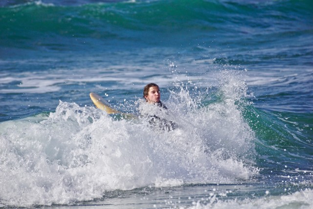 Surfer surviving the surf in Southern California